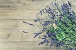 Lavender oil fresh flowers wooden background vintage toned. Lavender oil with fresh flowers on rustic wooden background, vintage toned picture Royalty Free Stock Images