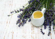Lavender oil with fresh lavender Stock Images