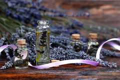 Lavender oil in a glass bottle Royalty Free Stock Images