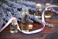 Lavender oil in a glass bottle Stock Photography