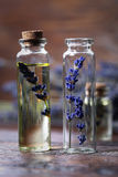 Lavender oil in a glass bottle Royalty Free Stock Image