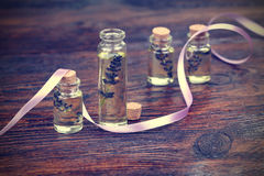 Lavender oil in a glass bottle Stock Photo
