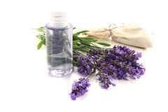 Lavender oil with Lavender bag. And fresh flowers on a light background Royalty Free Stock Photos