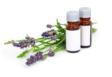 Lavender oil and lavender flower. Aromatherapy Lavender oil and lavender flower, isolated on white background Royalty Free Stock Photo