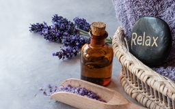 Lavender oil and stone spa. SPA, essential oil with lavender flowers - health and beauty, stone spa stock image