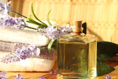 Lavender oil with towels Royalty Free Stock Photos
