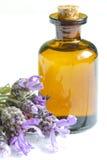 Lavender oil on white planks closeup Stock Images