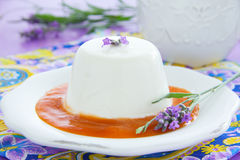 Lavender panna cotta. With peach puree stock image