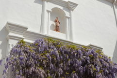 Lavender Pillars. Lavender colored pillars with a gold statue. Taken at a Spanish Californian Mission Stock Photo