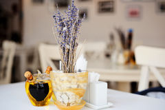 Lavender in pot and olive oil on white table. White table in the restaurant with lavender in pot and olive oil stock image