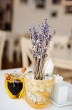 Lavender in pot and olive oil on white table Stock Photos