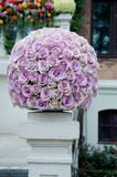Lavender roses centerpiece flower ball. Lavender rose flower ball, a large outdoor festive centerpiece standing on the stairs with a white fence and colorful royalty free stock image