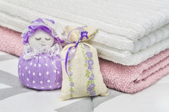 Lavender sachet and scented pouch figure and character representing a girl or woman. Close up to dried lavender in decoration bags stock image