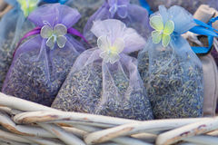 Lavender Satchets in a white basket. Small, decorative mesh bags of dried lavender flowers arranged in a white basket stock photos