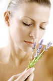 Lavender scent. Female enjoying the scent of lavender, skin has been retouched to keep texture, no blur filters have been used royalty free stock photos