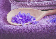 Lavender scented purpe bath salt in a wooden spoon Stock Images