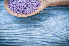 Lavender sea salt for skincare in wooden spoon on wood board top Stock Images