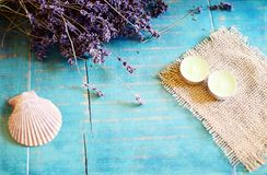 Lavender spa concept. Lavender, seashell and tea candles on turquoise wooden background Royalty Free Stock Photo