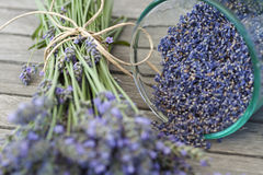 Lavender seeds. Spilling out of a plant on a wooden table stock photos