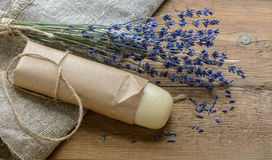 Lavender soap with a bouquet of dried lavender on a wooden background Royalty Free Stock Photos