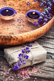 Lavender soap and candles in water Royalty Free Stock Photo