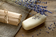Lavender soap with dried lavender flowers on a wooden background Royalty Free Stock Images