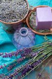 Lavender soap and perfume oil, made from fresh lavender flowers, aroma spa treathment and bodycare for women. Lavender soap and natural perfumed oil, made from royalty free stock photo