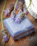 Lavender soap on wooden table Stock Photos