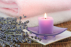 Lavender spa. Candle,towels,dried flowers Royalty Free Stock Photo