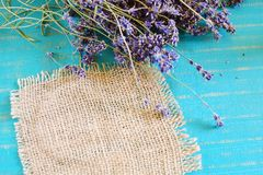Lavender spa concept. Lavender and burlap cloth on turquoise wooden background Stock Images
