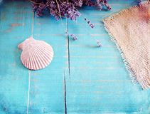 Lavender spa concept. Lavender and seashell on turquoise wooden background Royalty Free Stock Photos