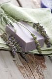 Lavender spa set. Spa set - fresh lavender and organic lavender soap over old wooden tray. best suited for relaxing and health commercials Royalty Free Stock Photography