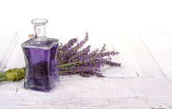 Lavender spa still life. With bottle of lavendar infused oil on a vintage door Royalty Free Stock Image