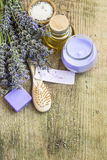 Lavender spa still life with label, candle, flowers and body-car Stock Photos