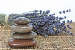 Lavender and stones. On bamboo mat Stock Photo
