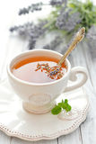Lavender tea. In cup closeup on wooden background Royalty Free Stock Photo
