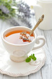 Lavender tea. In cup closeup on wooden background Stock Photo