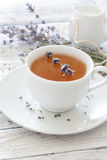 Lavender tea. Cup of lavender tea and lavender flowers royalty free stock images