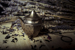 Lavender Tea Diffuser. I have always been a big lavender fan. I find it very soothing. I shot this image of a white teacup and some lavender and black tea Royalty Free Stock Photos