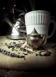 Lavender Tea Diffuser and Kettle. I have always been a big lavender fan. I find it very soothing. I shot this image of a white teacup and some lavender and black Royalty Free Stock Photos