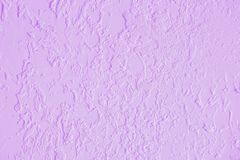Lavender textured plastered wall. Fresh otvetka in commercial premises, designer renovation in the house. Light lavender textured plastered wall. Fresh otvetka stock photo