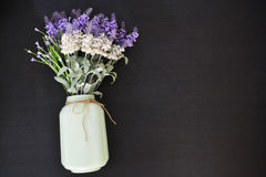 Lavender with vintage glass jar. Vintage glass jar with lavender on top of the wooden table Royalty Free Stock Images
