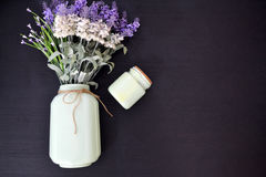 Lavender with vintage glass jar. Vintage glass jar with lavender on top of the wooden table royalty free stock photos
