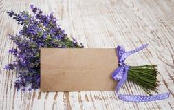 Lavender on vintage wood with blank. Lavender on vintage wood with old blank tag Royalty Free Stock Photos