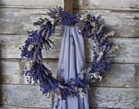 Lavender Wreath on old wooden wall. Closeup of Lavender wreath on old textured wooden wall stock images