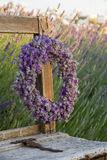 Lavender wreath in a summer garden. Lavender flower wreath on a wooden old bench in a summer garden Royalty Free Stock Photo