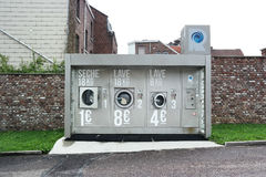 Laveries Révolution laundromat. HERVE, BELGIUM - JULY 2015: Laveries Révolution, commercial outdoor washing machines and dryer in a self-service laundry stock photos