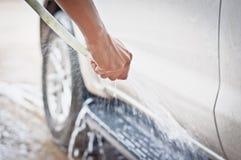 Lavez un véhicule Photos stock