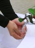 Lavi la vostra mano Immagine Stock Libera da Diritti