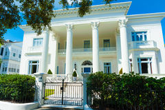 Lavish white greek revival style house with full length Corinthian columns Royalty Free Stock Photo